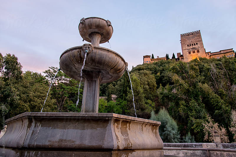 The fountain of Paseo de los tristes in front of Alhambra by Bisual Studio for Stocksy United