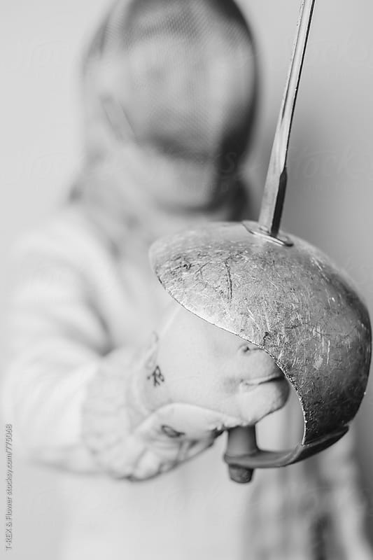 Photo of professional athlete holding fencing sabre. Soft focus by T-REX & Flower for Stocksy United