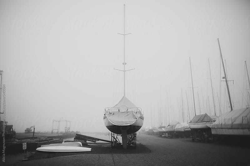 Sailboat in Dry Storage for the Winter in Black and White by Alicia Magnuson Photography for Stocksy United