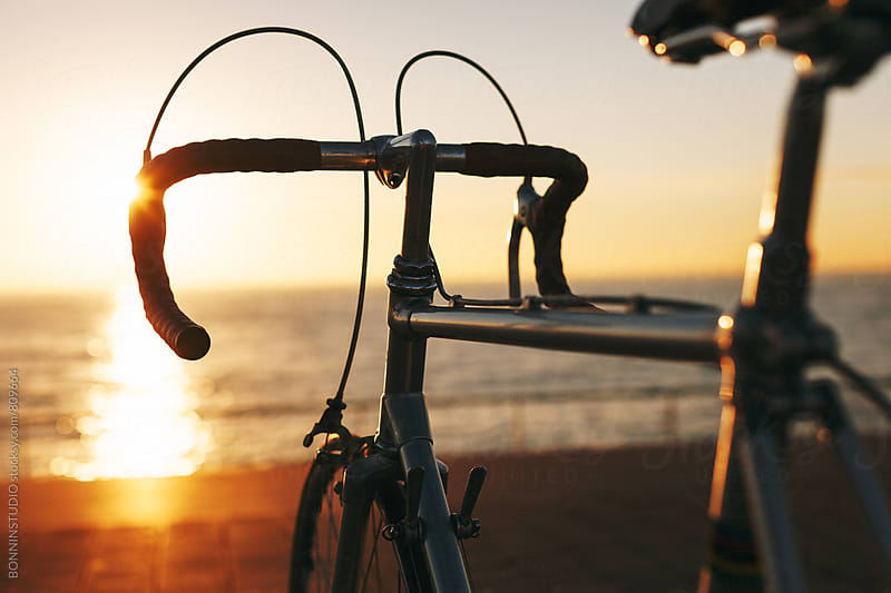 Vintage bicycle on sunrise at the sea. by BONNINSTUDIO for Stocksy United