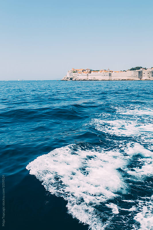 Dubrovnik seen from a boat by Maja Topcagic for Stocksy United
