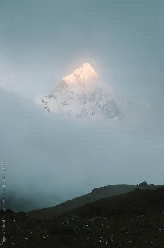 Cloud and mountain, Everest Region, Sagarmatha National Park, Nepal. by Thomas Pickard for Stocksy United
