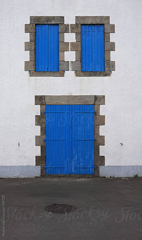 House with blue door and shutters by Marcel for Stocksy United