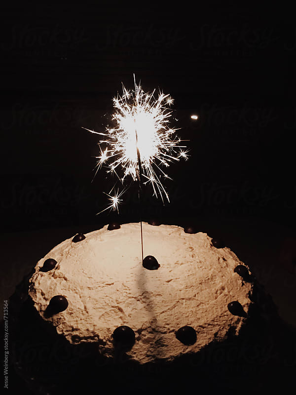 Sparkler in a Birthday Cake by Jesse Weinberg for Stocksy United