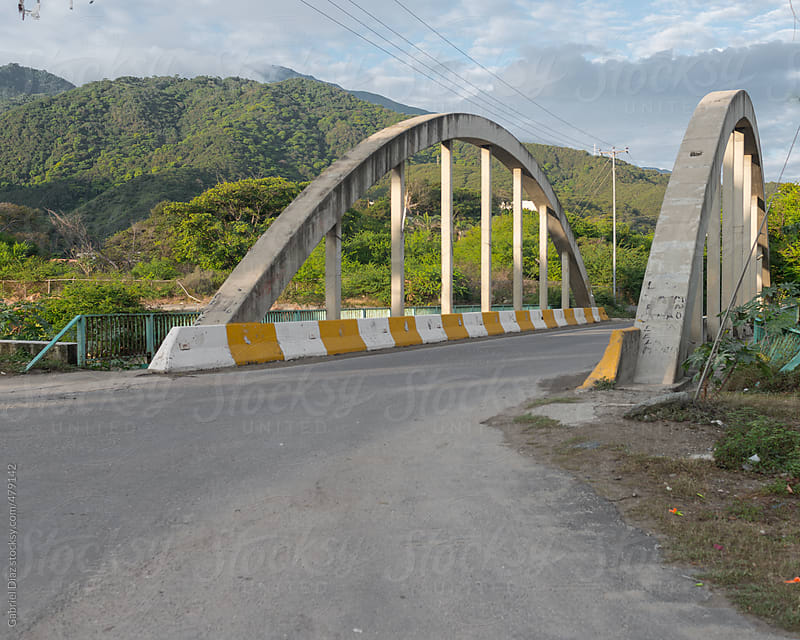 Concrete bridge to the beach by Gabriel Diaz for Stocksy United