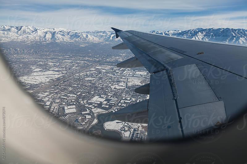 Window seat and snowy landscape below.  by Robert Zaleski for Stocksy United