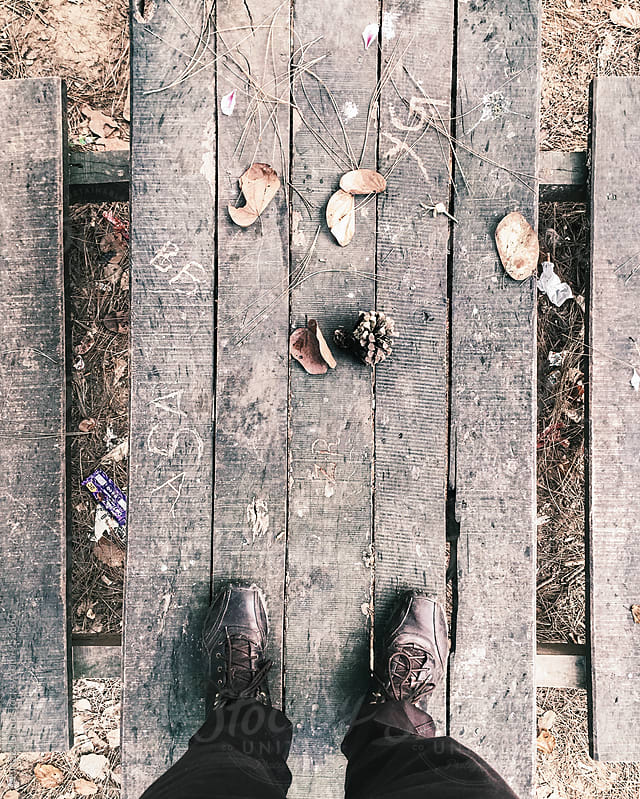 Standing on a wooden picnic bench by Murtaza Daud for Stocksy United