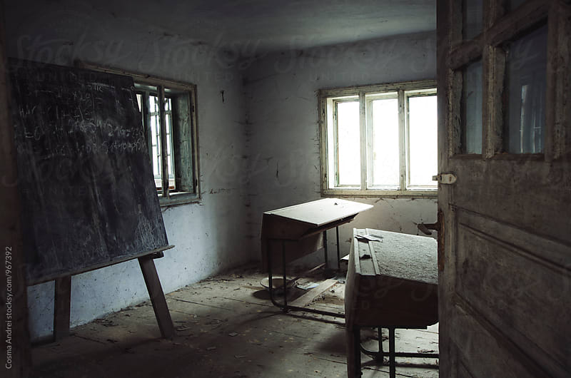 Abandoned old haunted classroom by Cosma Andrei for Stocksy United