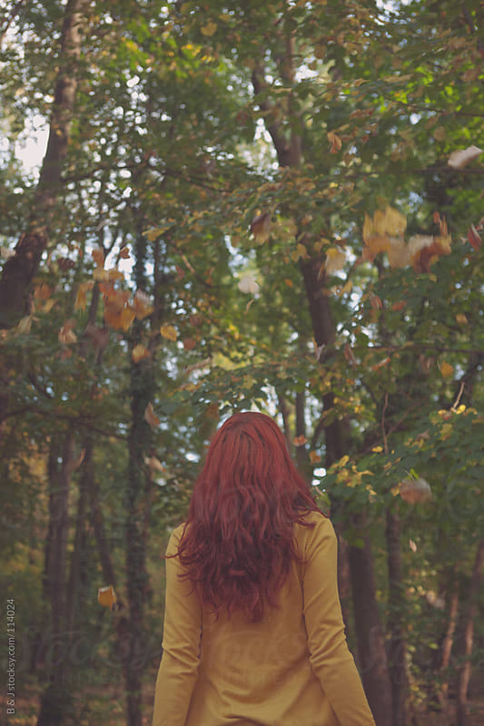 redhead girl in the woods by B & J for Stocksy United