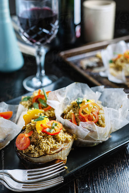 Baked onion and couscous tartlets. by Darren Muir for Stocksy United