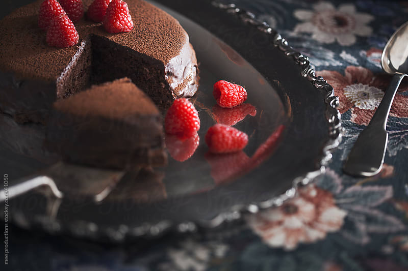 Chocolate cake and raspberries. by mee productions for Stocksy United