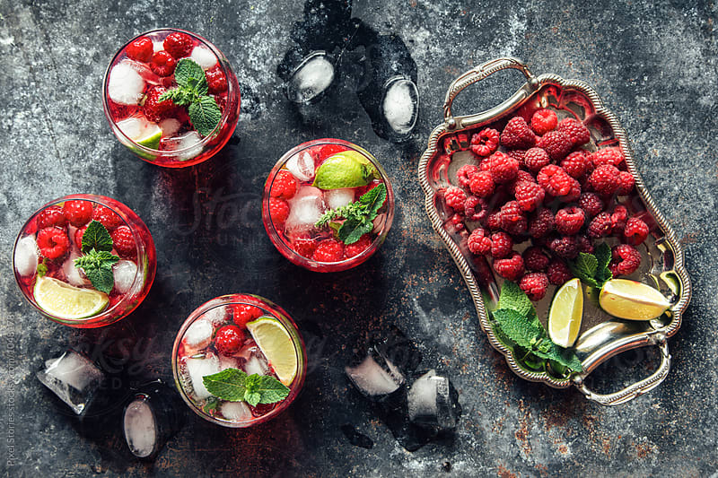 Raspberry mojito on metal table by Pixel Stories for Stocksy United