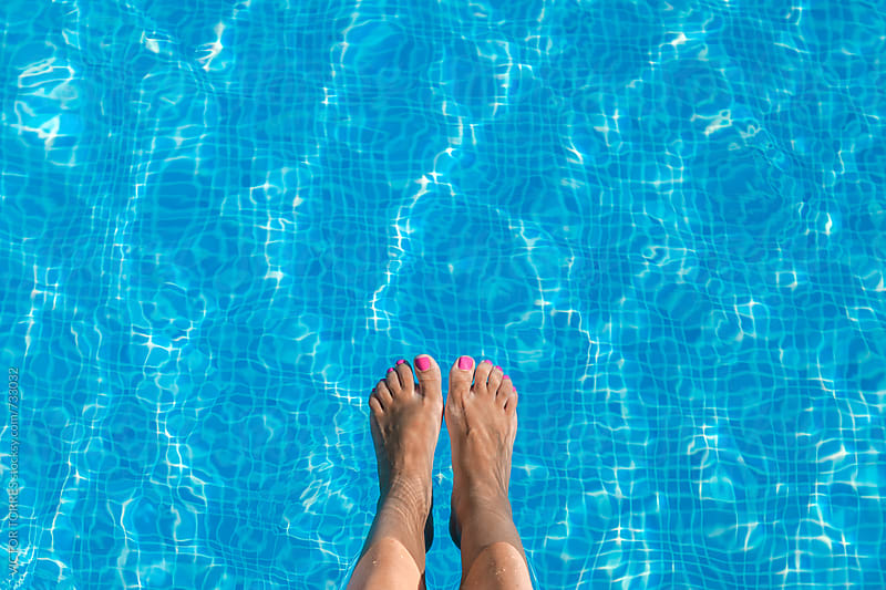 Woman Feet in the Pool by Victor Torres for Stocksy United