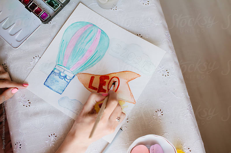 girl draws a picture of watercolor by Sergey Filimonov for Stocksy United