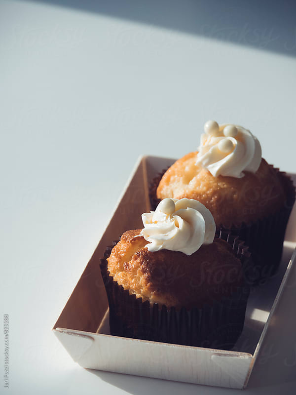 two frosted cupcakes by Juri Pozzi for Stocksy United