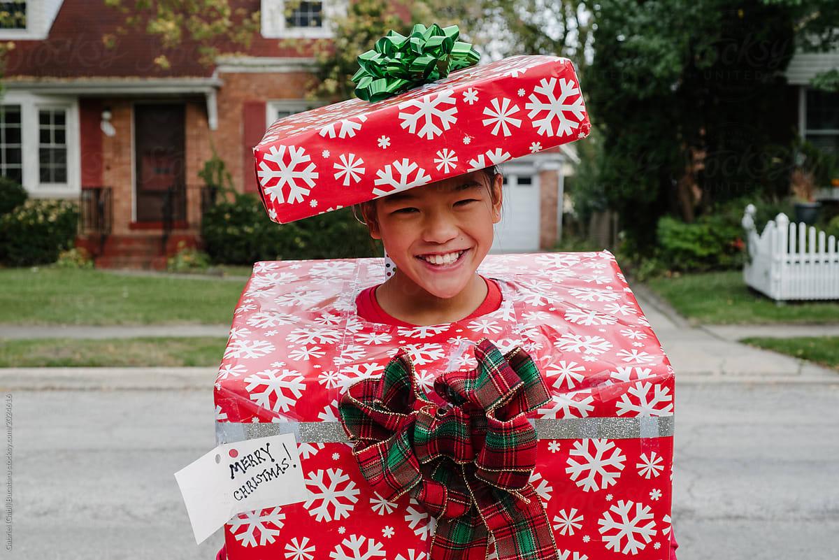 Smiling Asian Girl In Christmas Gift Costume | Stocksy United