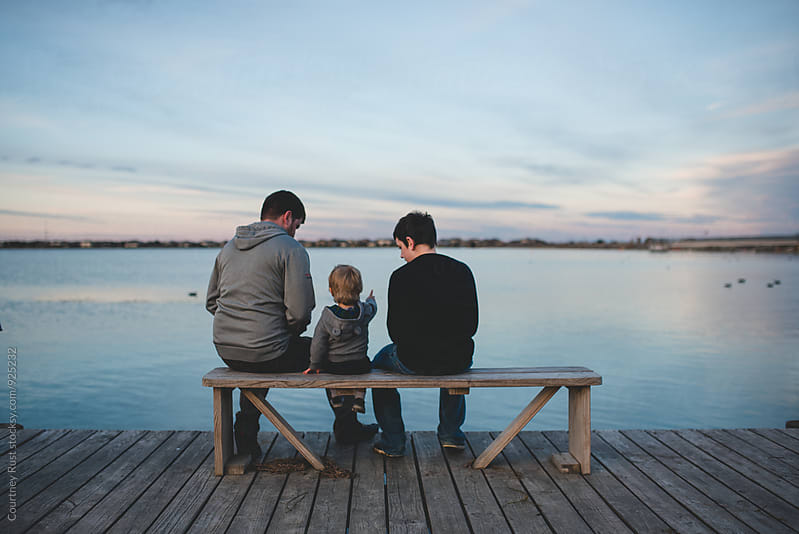 Father and sons share a moment by Courtney Rust for Stocksy United