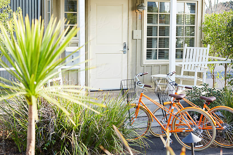 Cruiser bikes in front of cute tiny home cottage by Trinette Reed for Stocksy United