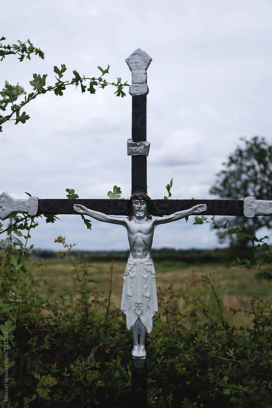 Religious cross at roadside by Marcel for Stocksy United