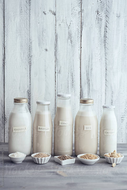 Food: Different vegan milk sorts in glass bottles by Ina Peters for Stocksy United