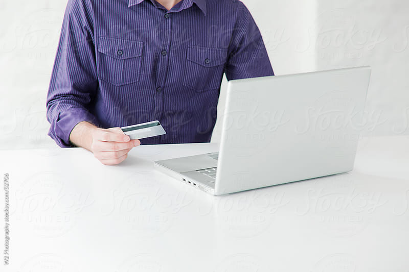 Man online shopping and banking with credit card. by W2 Photography for Stocksy United