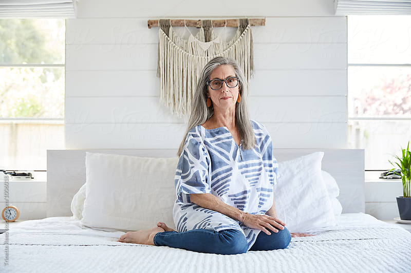 Portrait of senior woman with grey hair at home by Trinette Reed for Stocksy United
