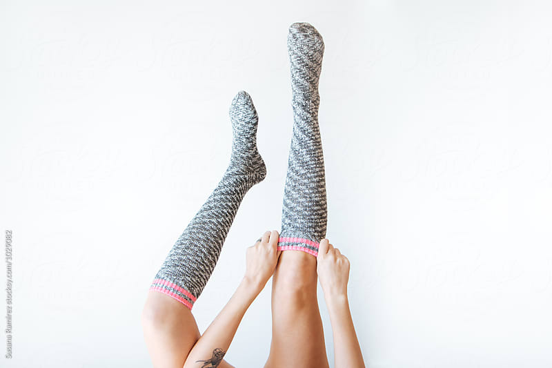 Legs of woman with high socks by Susana Ramírez for Stocksy United