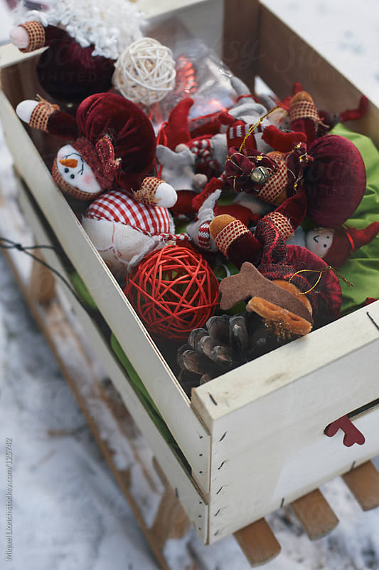 Sled loaded with christmas ornaments  by Miquel Llonch for Stocksy United