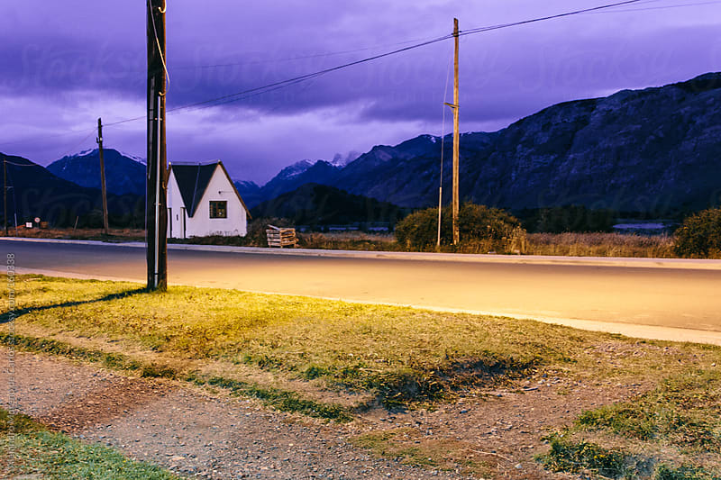 House and road on mountain village at sunset - night in Chalten, Argentina, Patagonia by Alejandro Moreno de Carlos for Stocksy United