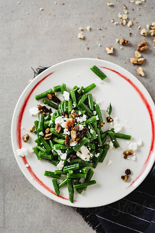 Green beans with goat cheese and walnuts by Tatjana Ristanic for Stocksy United