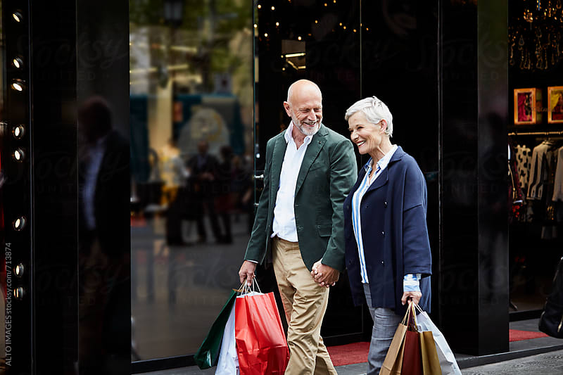 Senior Couple With Shopping Bags By Store by ALTO IMAGES for Stocksy United