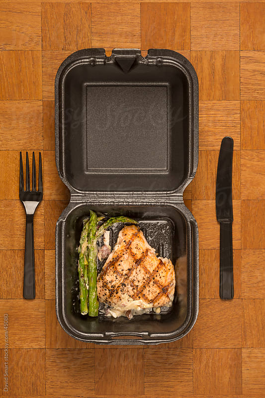 Leftover food from a restaurant meal in a takeout box by David Smart for Stocksy United