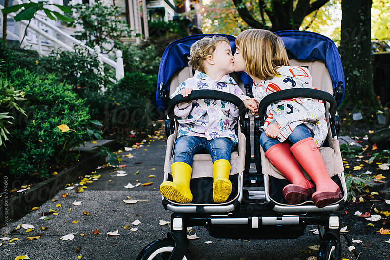Hand holds and stroller kisses by Ali Lanenga for Stocksy United