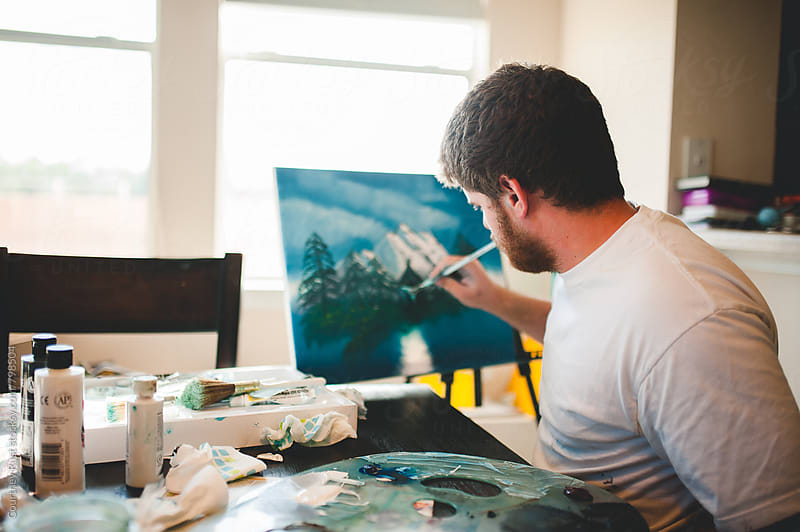 Painting a landscape by Courtney Rust for Stocksy United