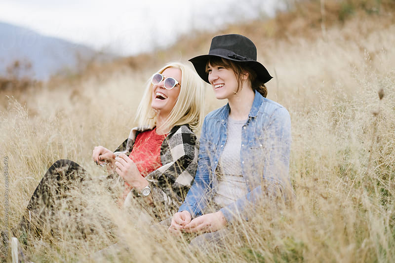 Friends Laughing and Enjoying Nature  by Aleksandra Jankovic for Stocksy United
