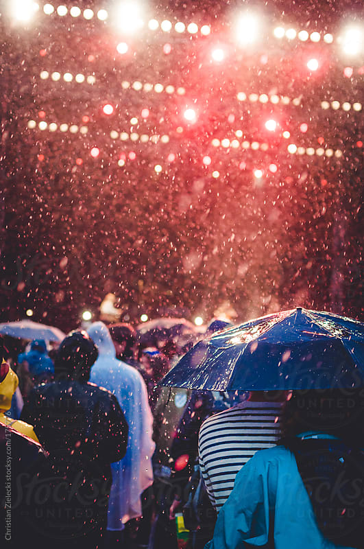 crowd in the rain of a festival by Christian Zielecki for Stocksy United
