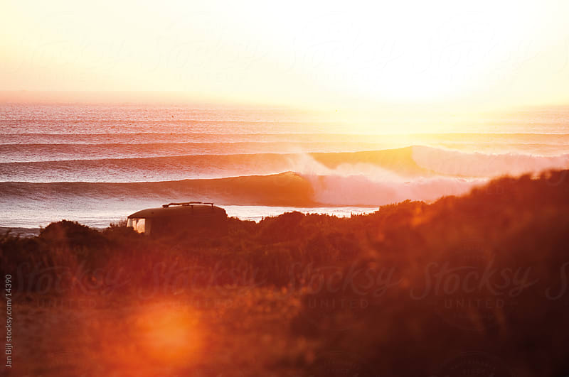 camper van overlooking Perfect sunset surf  by Jan Bijl for Stocksy United
