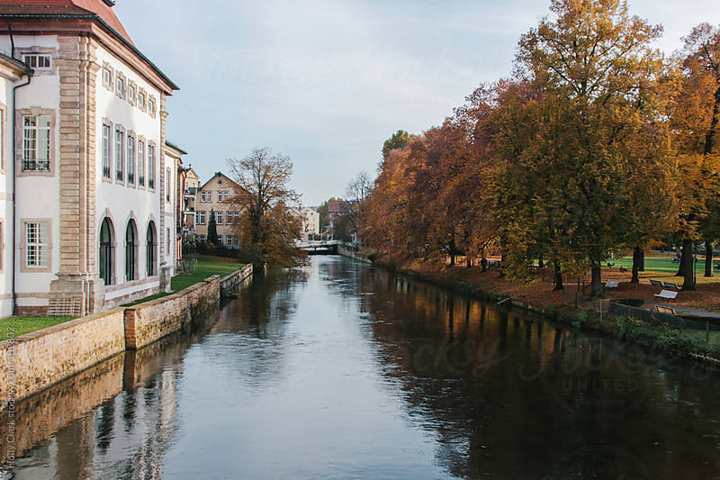 A river runs through an old German town,  Esslingen, Baden-Württemberg by Holly Clark for Stocksy United