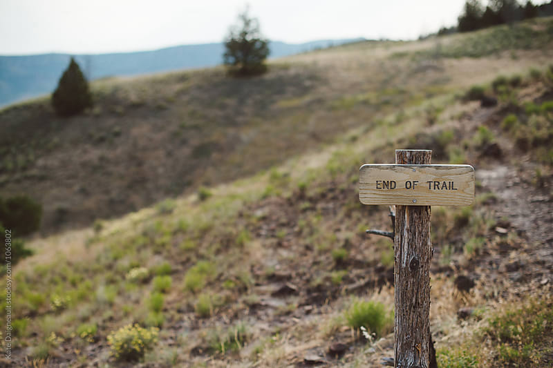 End of Trail sign on open hike. by Kate Daigneault for Stocksy United