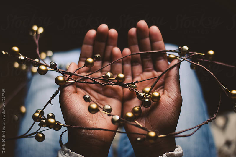 Hands with Christmas Decorations by Gabriel (Gabi) Bucataru for Stocksy United