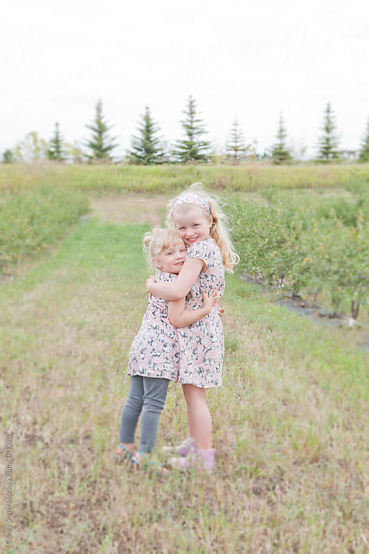 Children hugging by Carey Shaw for Stocksy United