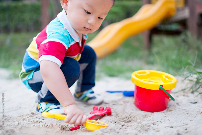 Kid playing in sandpit by Lawren Lu for Stocksy United