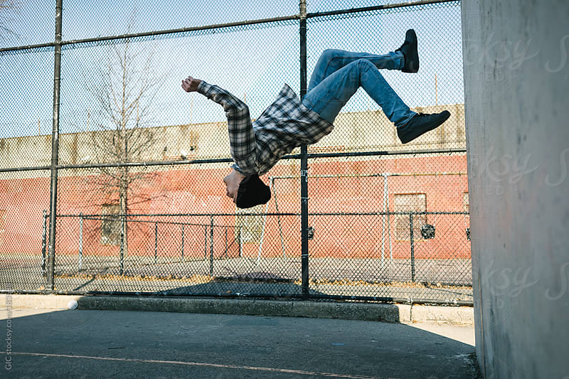 Young man flipping in the park by GIC for Stocksy United