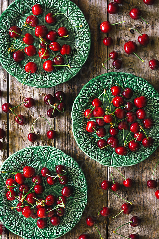 Cherries in dishes by Pixel Stories for Stocksy United