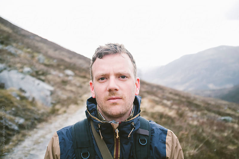 A portrait of a tired male walker or hiker in the Scottish Highlands by Ivo de Bruijn for Stocksy United