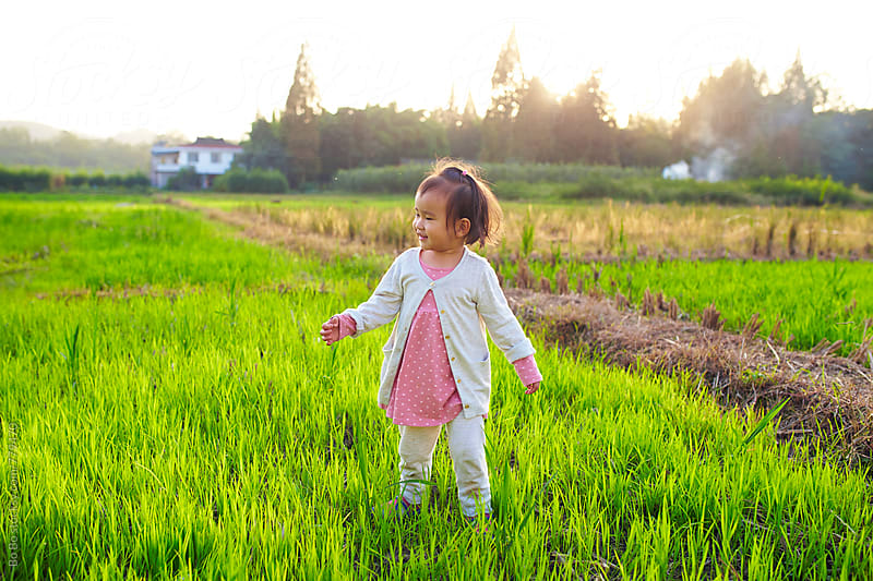 lovely little asian girl in the countryside by cuiyan Liu for Stocksy United