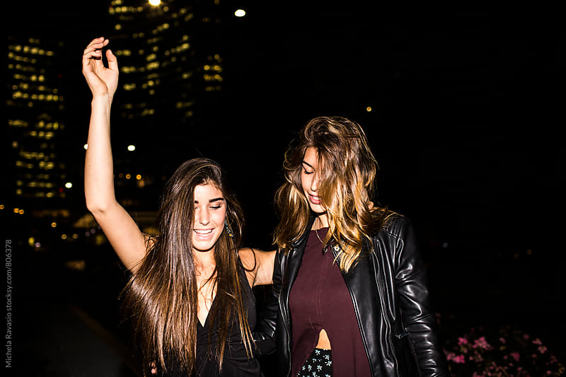 Best friend woman having fun together at night by michela ravasio for Stocksy United