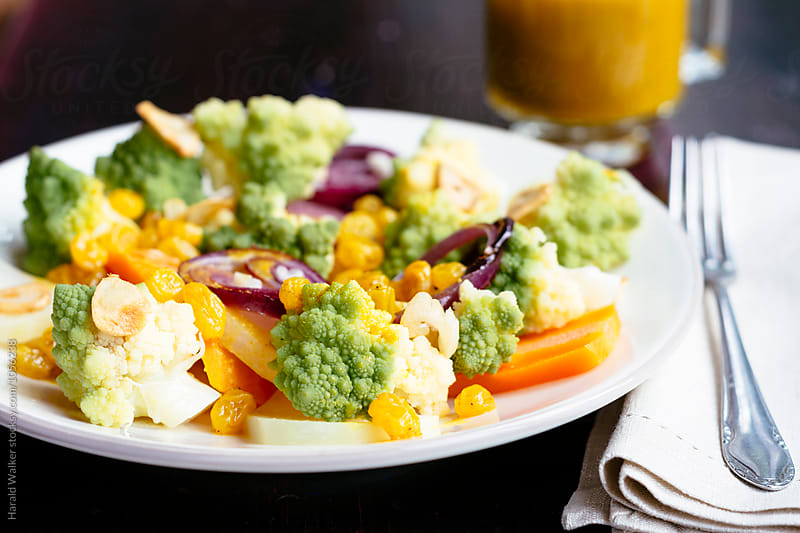 Warm Summer Vegetables with an Orange, Turmeric Raisin Dressing by Harald Walker for Stocksy United