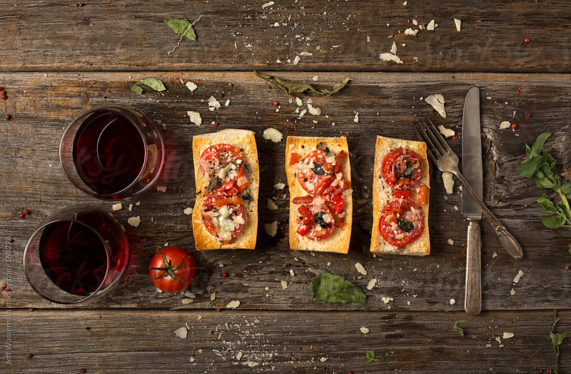 Crostini with Tomato, Parmigiano Reggiano and Herbs by Jeff Wasserman for Stocksy United
