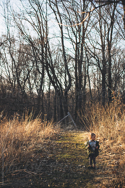 Young Girl Standing on a Hiking Trail by Kevin Keller for Stocksy United